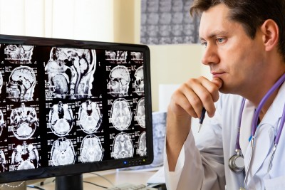 CT scan: Doctor viewing CT scan